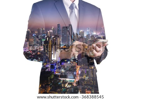 Double exposure of business man hand hold and touch screen smart phone, mobile and night city - stock photo