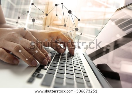 Double exposure of business man hand working on blank screen laptop computer on wooden desk as concept with social media diagram   - stock photo