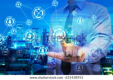 Double exposure of business man touch on virtual screen with night modern city building background
