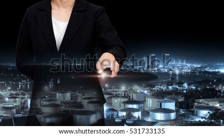 Double exposure of business with night refinery blurred background