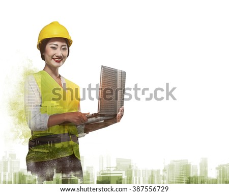 Double exposure of business woman in safety vest working with laptop - stock photo