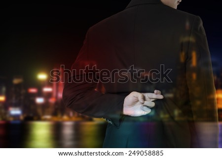 double exposure of businessman cross finger - stock photo