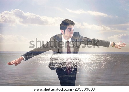 Double exposure of businessman flying and seascape