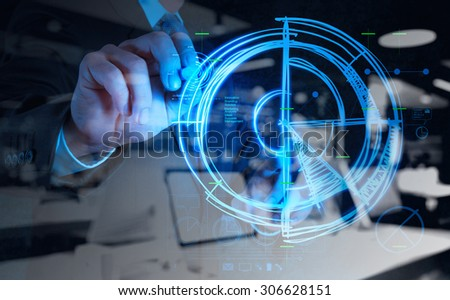 double exposure of businessman hand drawing a chart on new modern computer - stock photo