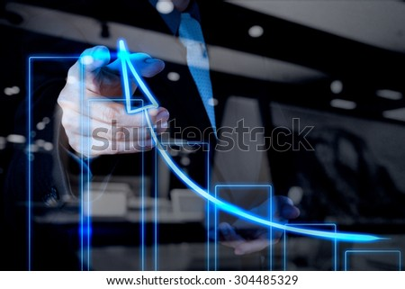 double exposure of businessman hand drawing virtual chart business on touch screen computer - stock photo