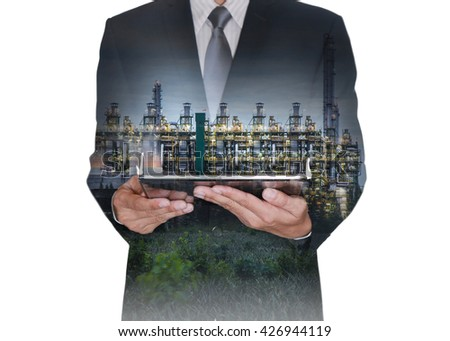 Double exposure of businessman hand hold tablet, gas refinery industry plant and oil refinery factory isolated white background as Business and Research of Energy concept.