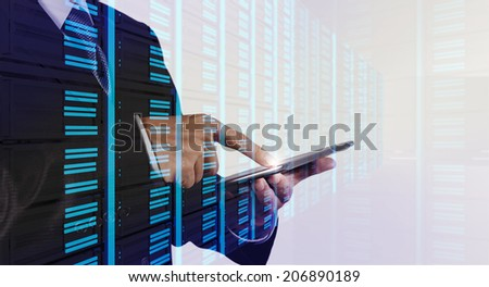 Double exposure of businessman hand pressing a touchscreen button on server background - stock photo