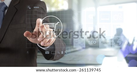 Double exposure of businessman hand shows modern technology as internet online shopping concept
