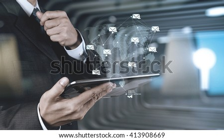 double exposure of businessman hand use smart phone computer with email icon as concept - stock photo