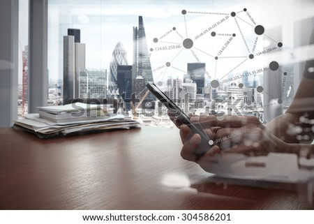 double exposure of businessman hand use smart phone with office workspace and social network diagram - stock photo