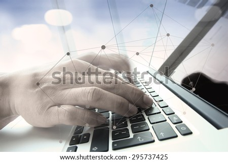double exposure of businessman hand working with business documents on office table with laptop computer with social media diagram - stock photo