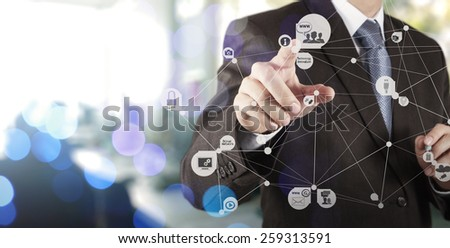 Double exposure of businessman hand working with new modern computer show social network structure as concept - stock photo