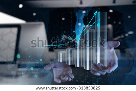 double exposure of businessman hand working with virtual chart business on touch screen computer as concept - stock photo