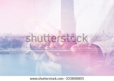 Double exposure of businessman hands with mobile smart phone, finger on touch screen of wireless device, cityscape in background, retro toned image, selective focus - stock photo