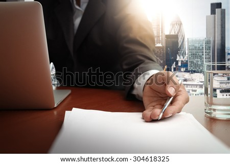 double exposure of businessman or salesman handing over a contract on wooden desk - stock photo