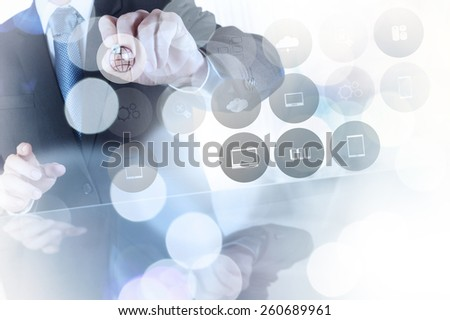 Double exposure of businessman shows modern technology icons as concept - stock photo