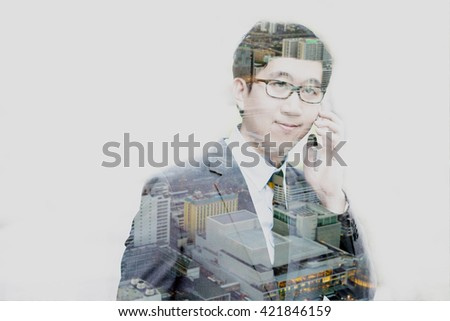 Double exposure of businessman talking on the phone with cityscape scene - stock photo