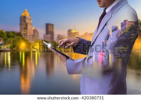 Double exposure of businessman use tablet with blur closed circuit camera background  technology as concept - stock photo