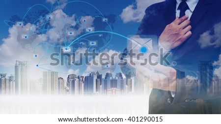 Double exposure of businessman using the tablet for sending the email on world map with network line over the cityscape background, business concept,Elements of this image furnished by NASA