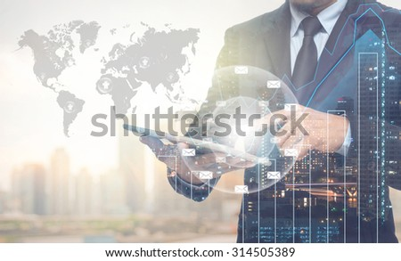 Double exposure of businessman using the tablet with cityscape and financial graph on blurred building with world map and mail background, Elements of this image furnished by NASA - stock photo