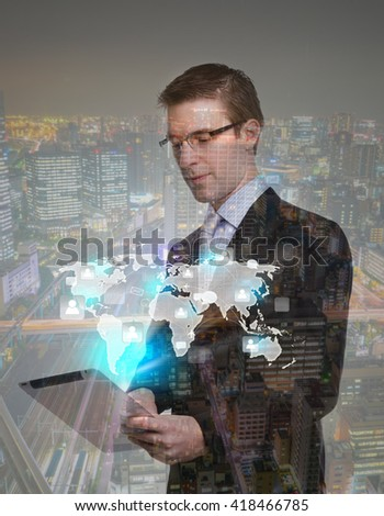 Double exposure of businessman using touch screen device with cityscape