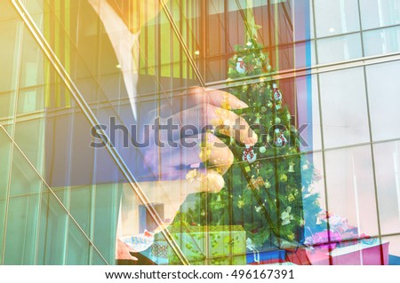 Double Exposure of Businessman with Christmas tree and Gift box or Presents as Christmas Celebration or New Year