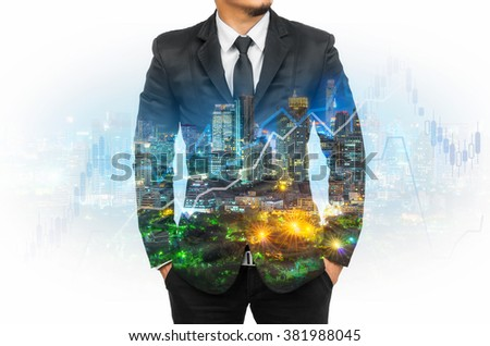 Double exposure of businessman with cityscape and financial graph on blurred building background.