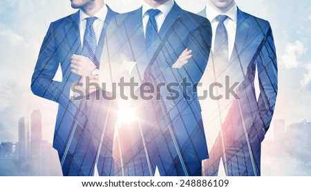 Double exposure of businessmen and skyscraper on megalopolis background