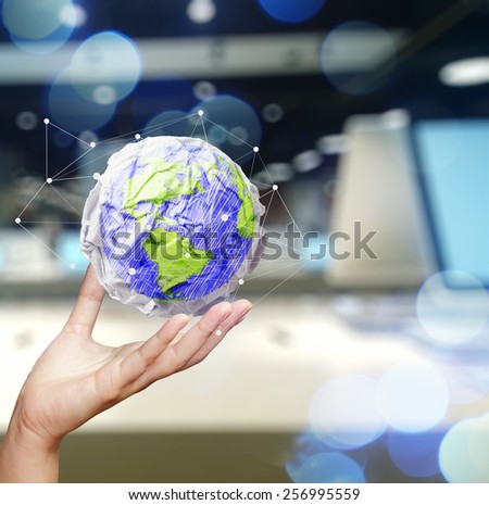 double exposure of businesswoman hand showing crumpled paper and the world with digital social media network concept - stock photo