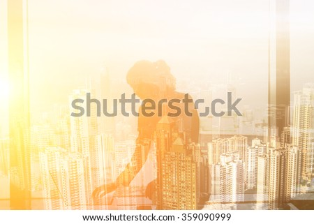 Double exposure of businesswoman work near window in hotel room. - stock photo