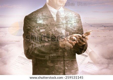 Double exposure of city and business man using smart phone on the cloud - stock photo