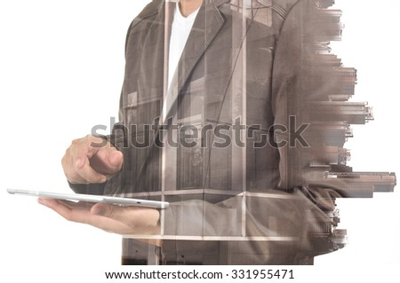 Double exposure of city and Businessman use Tablet device as Business development concept. - stock photo