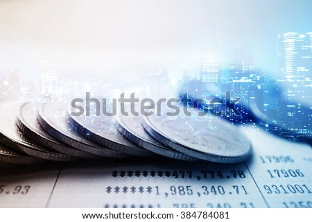 Double exposure of city and rows of coins for finance and banking concept - stock photo