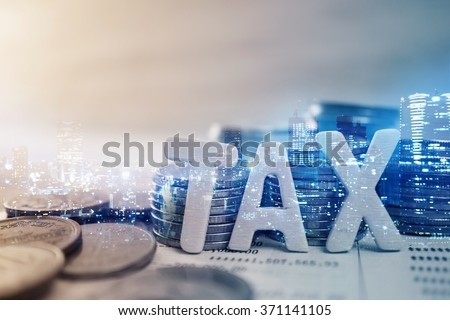 """Double exposure of city, """"tax"""" wooden text and rows of coins for finance and banking concept - stock photo"""