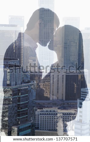 Double exposure of couple kissing over cityscape - stock photo