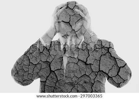 double exposure of depressed business man and dry ground background - stock photo