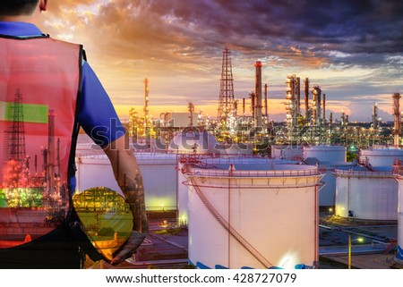 Double exposure of Engineer  with safety helmet in front of Oil refinery and gas industry - refinery at sunset  background, Business Insustrail concept - stock photo