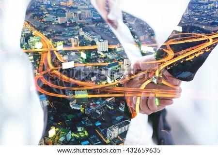 Double exposure of handshake with night city blured background. - stock photo