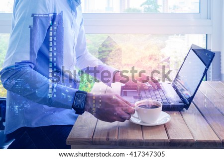 Double exposure of  man holding coffee cup and typing a laptop on wooden table.