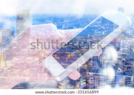 Double exposure of man using smart phone and cityscape background ,Business technology concept.  - stock photo