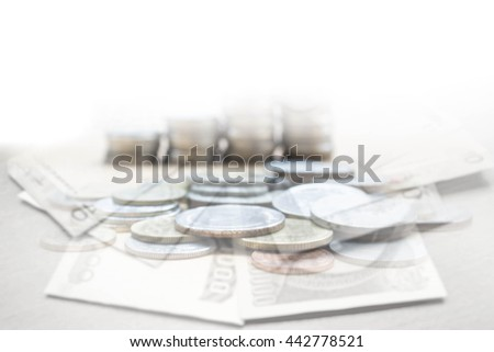 double exposure of money bills and stack of coin : concept of collect money - stock photo
