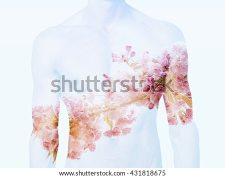 double exposure of muscular male torso and cherry blossom - stock photo