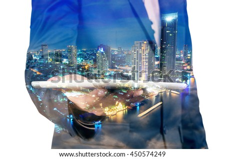 Double exposure of Night city and business man using digital tablet device as Business development concept. - stock photo