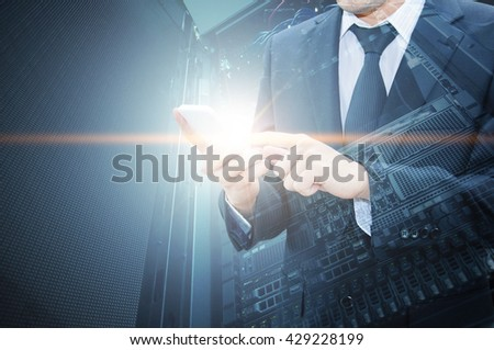 Double exposure of professional businessman using smart phone with servers technology in data center and network connection in IT Business technology concept - stock photo