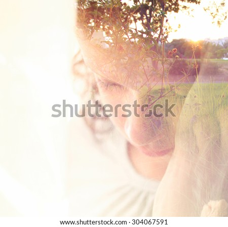 Double exposure of romantic nature landscape and cute happy kid  - stock photo