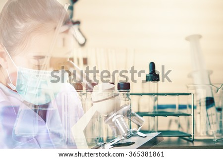 Double exposure of scientist or doctor use microscope with equipment and science experiments background , science research,science background - stock photo