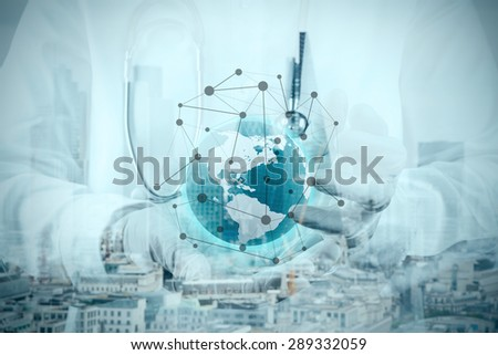 double exposure of smart medical doctor hand showing network with globe as medical network and media concept - stock photo
