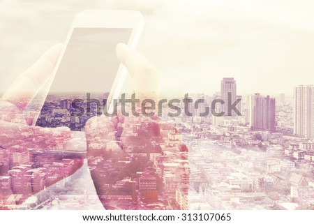 Double exposure of smart phone and cityscape background