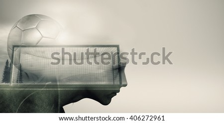 Double exposure of soccer player with a ball and soccer field - stock photo