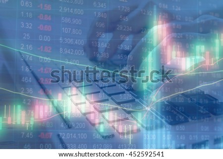 Double exposure of stocks market chart and stock data in blue on LED display with women hand using laptop computer background.